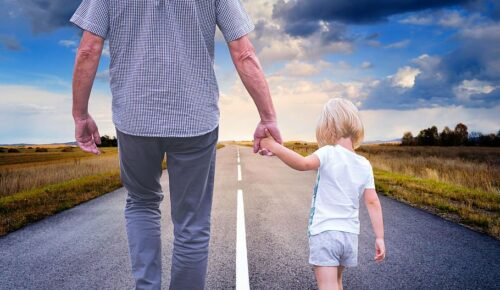 This image has an empty alt attribute; its file name is father-son-walking-road.jpg
